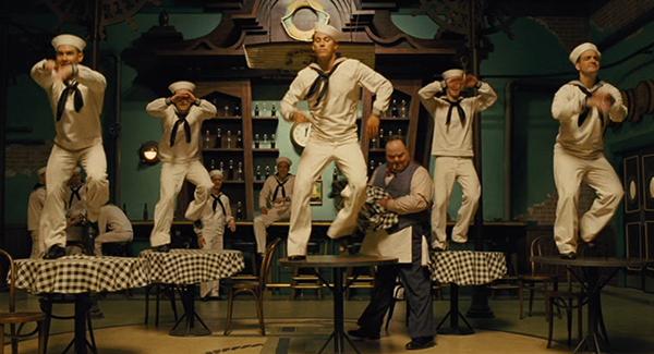 Burt dances on the table